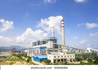 Coal-fired power plants under the blue sky white clouds