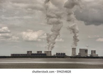 coal-fired power station with columns of steam, columns of smoke