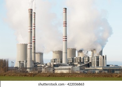 A coal-fired power station in the distance in agricultural landscape. Pocerady, Czech republic