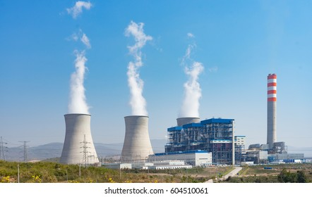 A coal-fired power station in the distance in agricultural landscape. The power station Niederaussem has the second highest cooling tower in the world