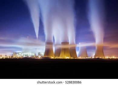 coal-fired power station in the distance at night. Pocerady, Czech republic