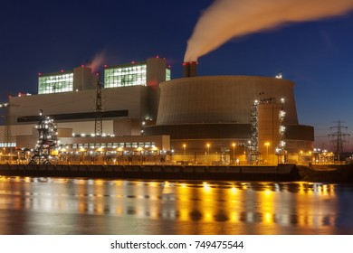 Coal-fired power station in Hamburg, Germany at night with smoke