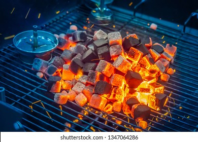 Coals for hookah. On the grill burn coals. Accessories for hookah. Coal ignition Coconut coal. Restaurant with hookahs.
