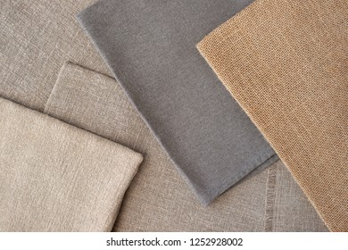 Coarse fabric creates for design. Textured background in the form of burlap and coarse cotton. Design items and clothes from coarse fabric. Sewing, style and fashion.