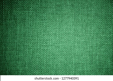 Coarse grained green pattern and textured of burlap sack or sackcloth (Hessian) made of jute rope use for sacking or bagging