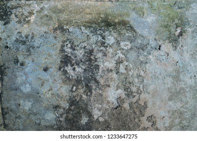 Coarse gray plaster and stain.