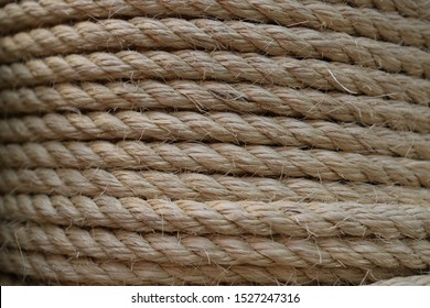 Coarse rope made of natural fiber material - sisal plant. Macro photo of texture, background
