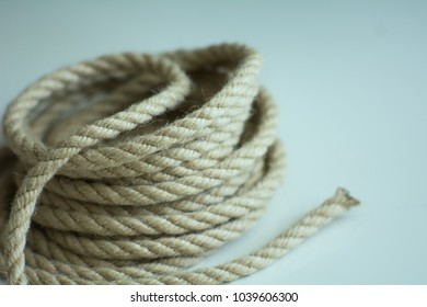 Coarse rope roll on a light surface.