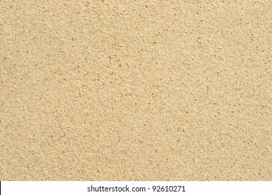 Coarse sand background texture. Macro of coarse sand grains.