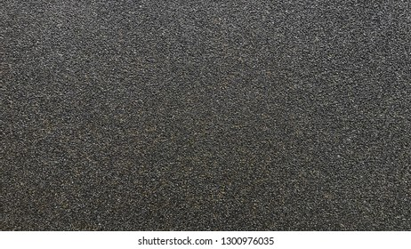 Coarse sand paper close up background texture.