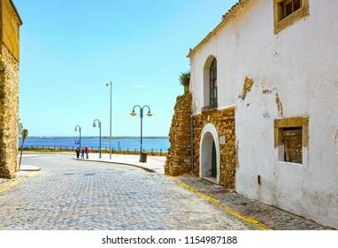 Coast of Atlantic Ocean in the city of Faro, Portugal. Summer sunny day.