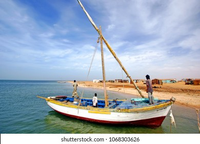 Coast of Banc d'Arguin National Park / Mauritania - photo taken December 01 / 2009 : boat with sails down and an fisher men onboard