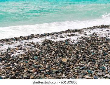 Coast beach of stones on a sunny day