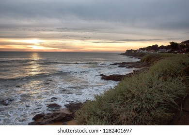 Coast of Britanny in France with the Atlantic ocean, the sunset on the beach.