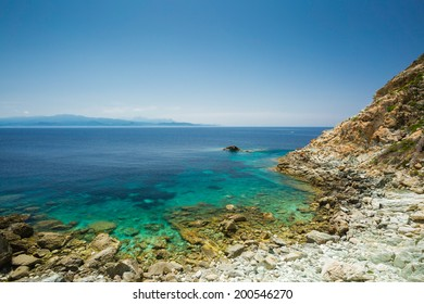 The coast of Cap Corse at Canelle in Corsica with the Desert des Agriates in the background