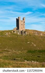 coast and castle of Dunstanburgh Castle northumberland england united kingdom europe