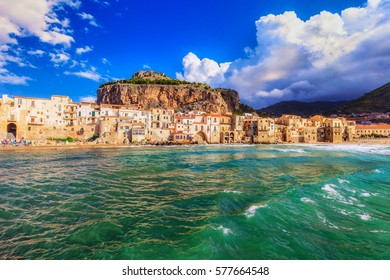 Coast of Cefalu in Sicily, Italy. European Coastal travel town with famous rock