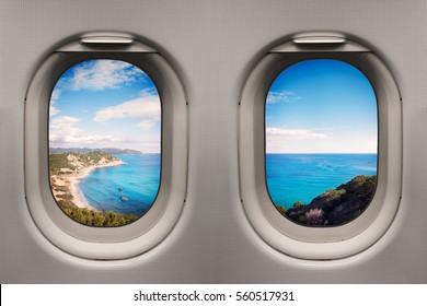Coast with clear blue sea and beach viewed from inside an airplane windows