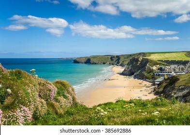 Coast of Cornwall with a Sandy Beach and Blue Sky
