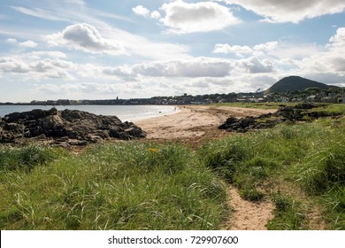 The Coast of East Lothian, Scotland. Views to North Berwick at the foot of North Berwick Law. The path along the coast is one alternative offered to walkers on the John Muir Way.