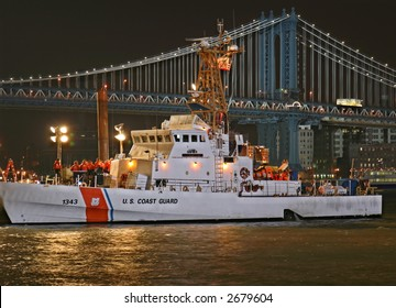 Coast Guard Cutter at Night with Bridge