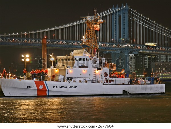 Coast Guard Cutter at Night with Bridge