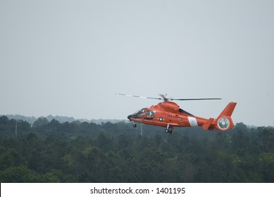 Coast Guard Helicopter HH65 low flight with gear down