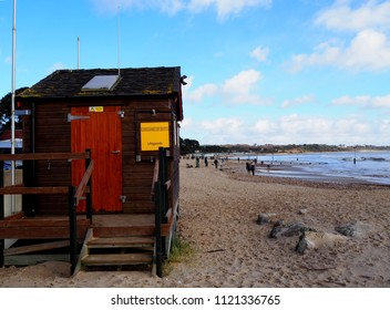Coast guard wooden hut, Mudeford, English. Mudeford beach is one of popular destination in Christchurch  for family. In summertime the beach is pack from visitors and coastguards are needed
