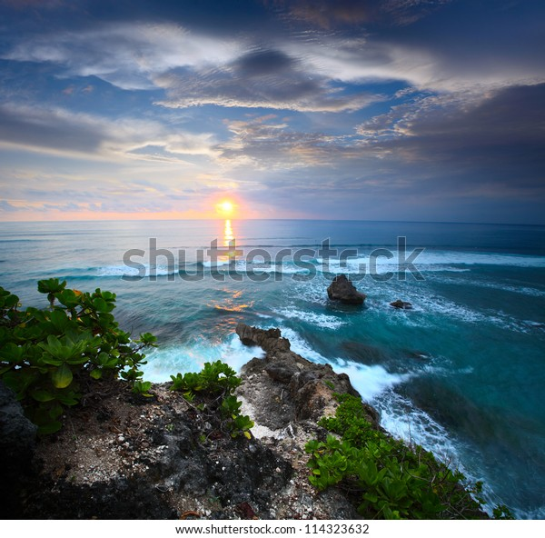 Coast of Indian ocean at sunset. South of Bali, Indonesia