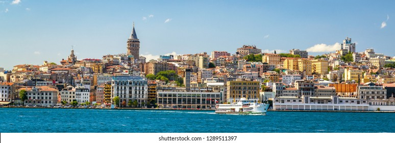 Coast in Istanbul, Turkey. Panoramic view of the Istanbul waterfront from Golden Horn. Beautiful cityscape of Istanbul with old Galata Tower in summer. Concept of traveling and vacation in Istanbul.