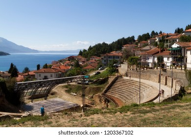 Coast of Lake Ochrid seen from Ochrid City. Ohrid and Lake Ohrid are UNESCO natural and cultural heritage sites. Typical Macedonian architecture. Amphitheater and old town.