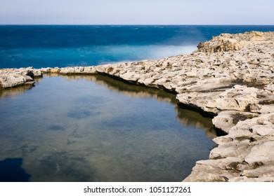 Coast landscape of Gozo Island. The Maltese archipelago limestone coastline, Dwejra Bay