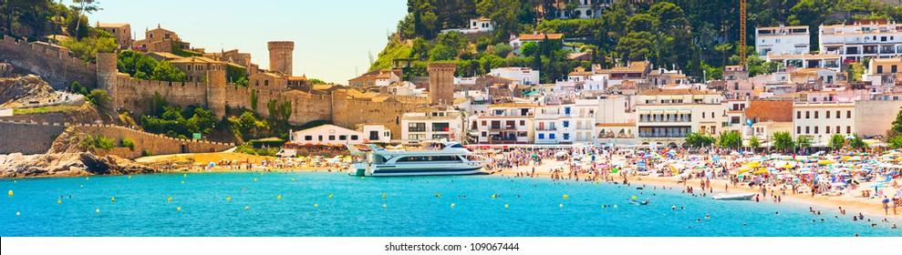 Coast line with  people under the sun (Panorama of Costa Brava, Tossa de Mar city, Spain)