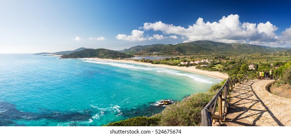 Coast with long beach, view from the promontory in a sunny day - Sardinia, Santa Margherita; Chia beach
