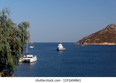coast of mediterranean sea with boats, yachts and catamarans in Patmos, Greece