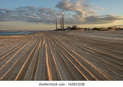 Coast of the Mediterranean Sea. Footprints in the sand. Ashkelon, power station