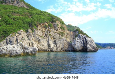 coast with a mountain chain and a secret bay on corfu island by daylight