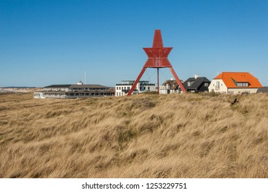 Coast of North Sea and Red monument in Lokken - Denmark.
