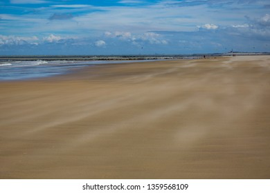 Coast of the North Sea at summer day. Sand beach. Knokke-Heist, famous seaside resort , Belgian province of West Flanders. Belgium. Tourist destination, beach holiday