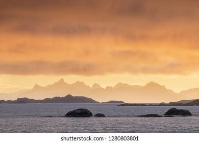 Coast of the of Norwegian fjords at sunset near Tromso Norway. Winter morning after sunrise. Lofoten