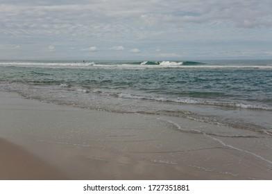 Coast on the East coast of Australia, Sunshine coast, evening deserted beach. Incoming waves of the Pacific ocean.