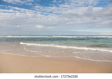 Coast on the East coast of Australia, Sunshine deserted beach and waves of the Pacific ocean.