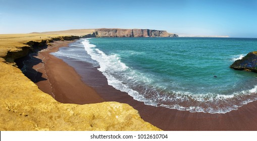 The coast and red sand beach of Paracas National Reserve in Peru