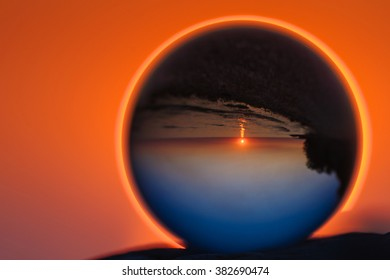 Coast reflected inside the crystal ball at sunset