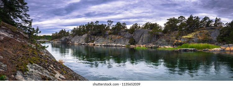Coast of a small island during Midsummer in the Swedish Archipelago, Sweden