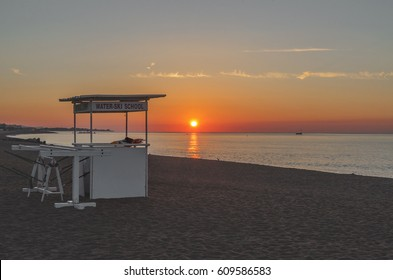 Coast in Spain Costa Brava, gazebo for surfers at sunset