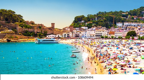 Coast with tanning and bathing people (Panorama of Costa Brava, Tossa de Mar city, Spain)