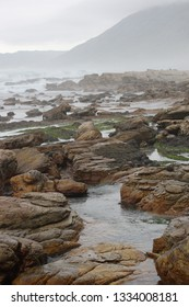 coast with tide pools in Scarborough, looking at Misty Cliffs, Cape Town, South Africa