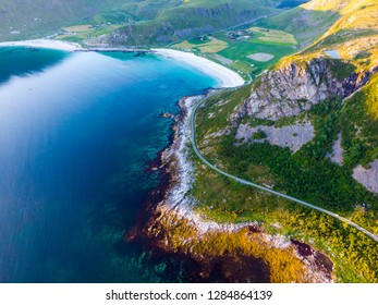 Coast of Vestvagoy island, Uttakleiv location. Seascape with scenic shoreline high mountains and sandy beach. Lofoten archipelago Northern Norway, Europe.