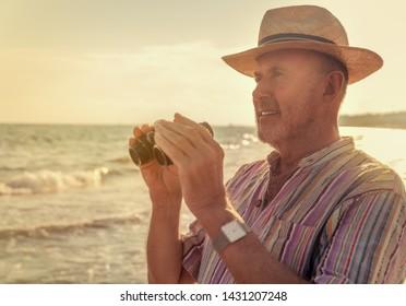 coast watching senior retired man